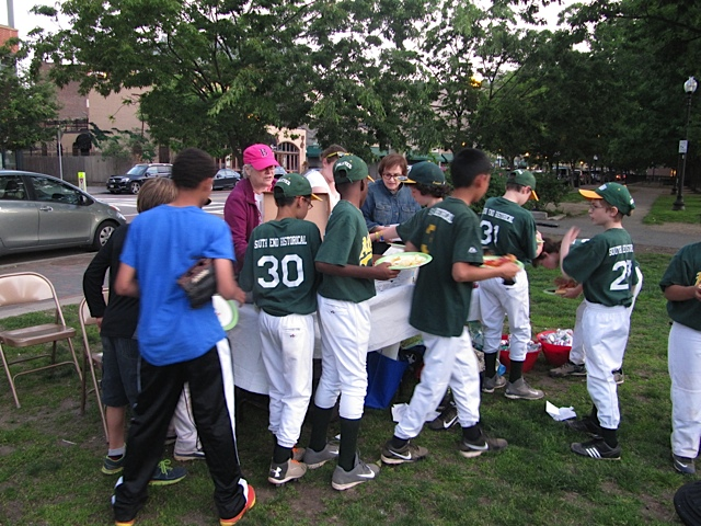 The team descends upon the pizza at our picnic for South End Baseball