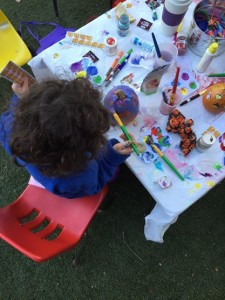 An artist at the SEHS Pumpkin Painting Party